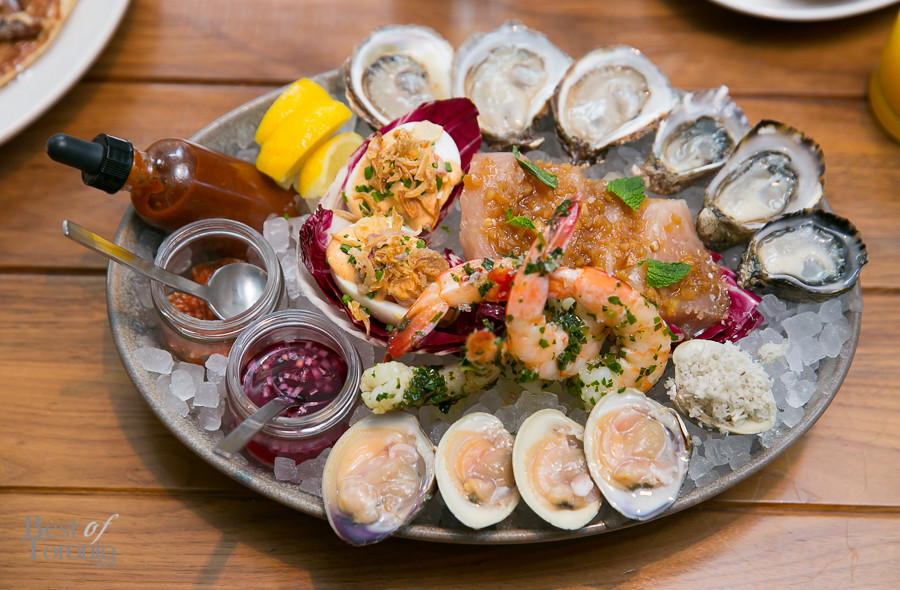 Small platter of fresh seafood with 2 varieties of oysters, clams, shrimp and deviled eggs