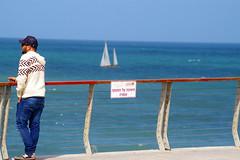 A young man looking out to the Mediterranean Sea, Jaffa (Yafo), Tel Aviv-Yafo, Israel