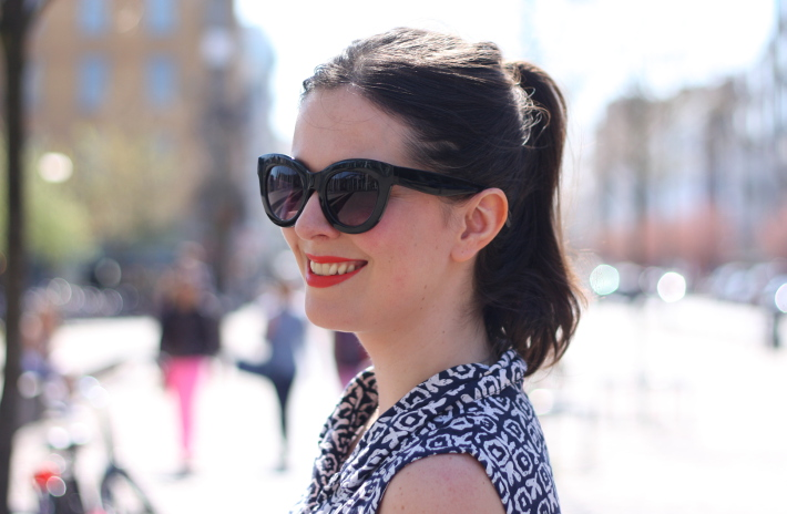 cat eye sunglasses, orange lipstick
