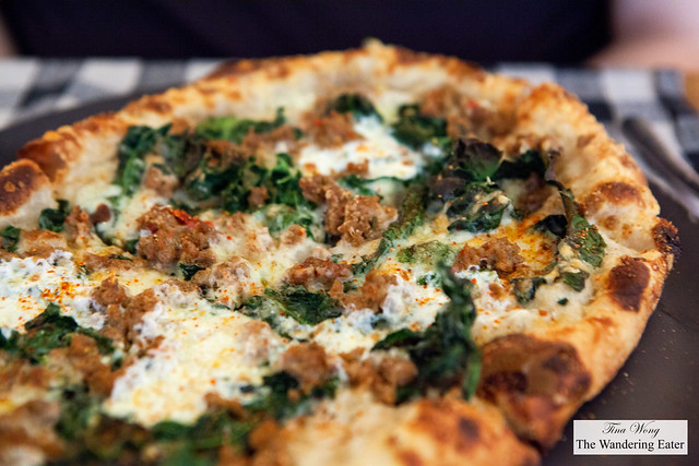 sausage + kale pizza, young pecorino, stracciatella and parmigiano