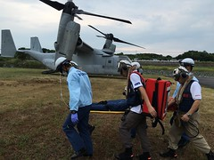Emergency medical service personnel practice carrying a victim on a stretcher to an MV-22 Osprey as part of a disaster drill sponsored by the city of Sasebo, Japan. (U.S. Navy/Lt. Adam Cole)