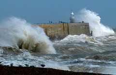 Seagulls shelter as Folkestone pier is battered by storm waves.