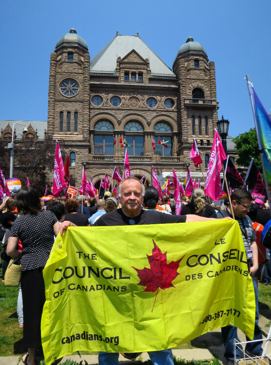 Guelph chapter activist Paul Costello at today's protest. Photo by Mark Calzavara.