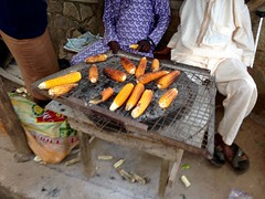 Roasting corn on a grill, Oke Omiru, Osun, Nigeria. #JujuFilms