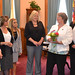 On behalf of the legislative women's caucus Rep. Jan Giegler presents a flower bouquet to House Republican Leader Themis Klarides in honor of her service and commitment to the state as Reps. Gayle Mulligan, Cara Pavalock, Theresa Conroy, Michelle Cook and Rosa Rebimbas look on.