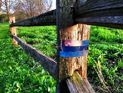 Winnemac Park fence post wrapped by Jet in Carina Nebula