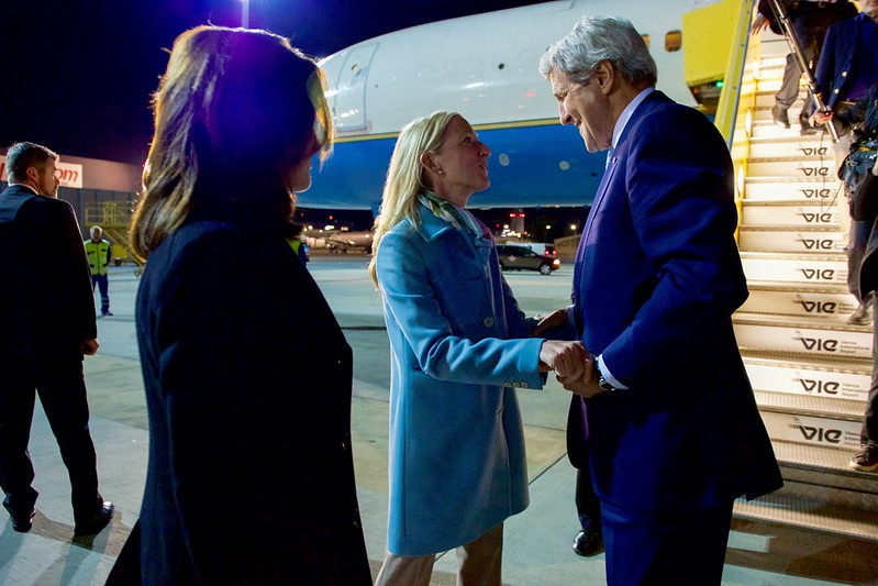 Secretary John Kerry Greets U.S. Ambassador to Austria Alexa Wesner After Deplaning at Vienna International Airport