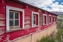 Old stable with peeling paint #oldstable #oldstables #peelingpaint #farm #farmlife #utah