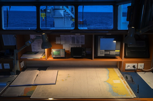 Nautical charts in the ship bridge