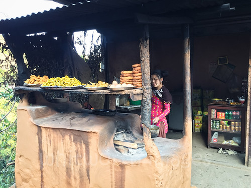 nepal food woman shop female person stand asia oven fastfood stall clay eggs snacks roadside nepali palpa indiansubcontinent selroti
