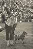 Notre Dame Leprechaun with Irish terrier mascot, Clashmore Mike, Notre Dame-Navy game, South Bend, Ind., Nov. 4, 1967