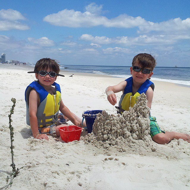 I'm not sure what's better: the boys drip castle or Connor's tinted goggles he wore all day on the beach. #adollopofvacation2015
