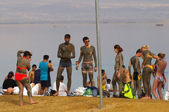 Group of people covered in mud, Ein Bokek Beach, the Dead Sea, Israel