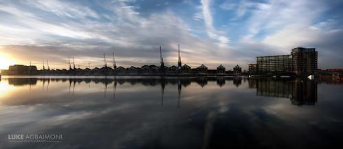 reflection london water clouds sunrise dusk docklands