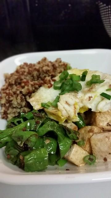 Breakfast - fried egg, shishito, tofu, and mixed quinoa