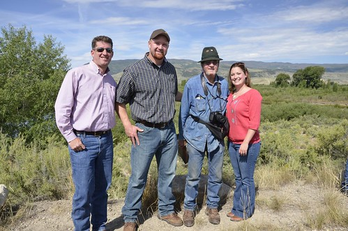 Chris West (who directed CCALT up until May 2015), left, celebrating conservation progress at the Yust ranch with Jay and Jim Yust, and CCALT's Carolyn Aspelin