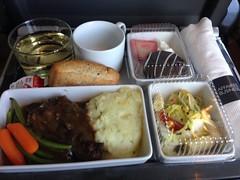 Dinner on the @VIA_Rail; beef, gravy potatoes, bread, coleslaw, dessert and white wine.