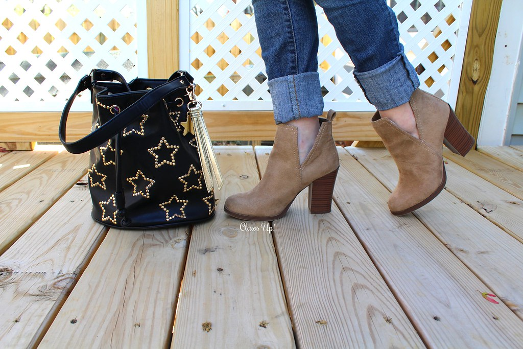 Betsey Johnson star bucket bag and beige booties.