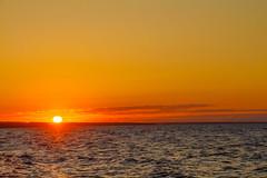 Big orange sun rising over Azov sea
