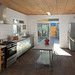 Sustainable Kitchen - Recycled Wood Flooring and Ceiling by Jeremy Levine Design