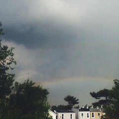 A sunshower, & then this magic ~ freshly-washed air, light like Connemara, & @yesequality {http://www.yesequality.ie} sparing no expense with a stunning rainbow beauty, thousands of miles from its Dublin homebase, in #CharmCity, though it is. Can you spot