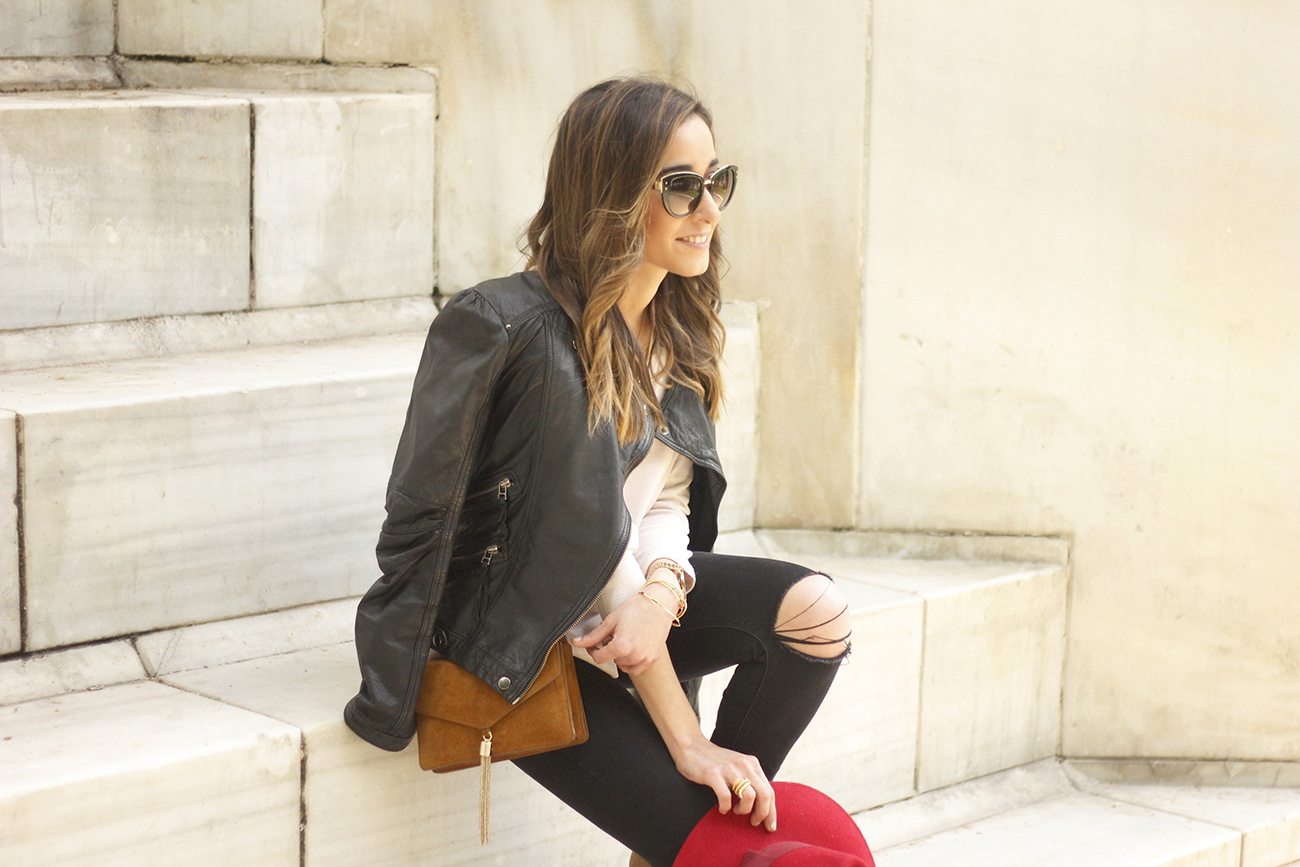 black biker jacket ripped jeans red hat camel bag outfit fashion style spring14