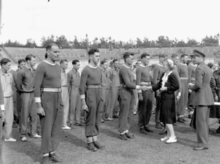 H.R.H. Princess Juliana presenting awards to members of the tug-of-war team of the South Saskatchewan Regiment... / Son Altesse Royale la princesse Juliana félicite les membres de l'équipe de souque à la corde du régiment South Saskatchewan...