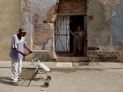 Man walking down a street in Old Havana, Cuba