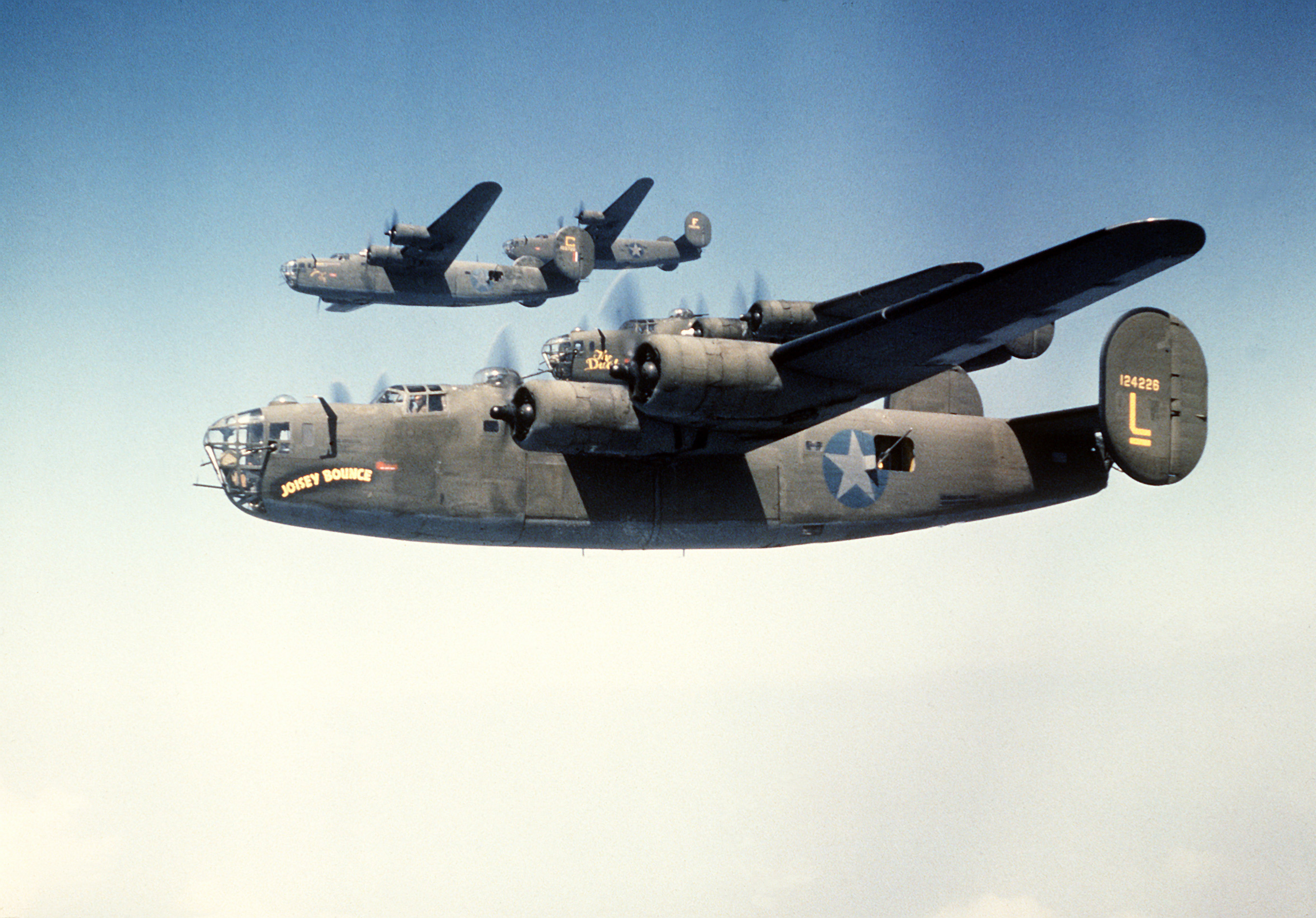 93rd Bomb Group formation flight. Near aircraft is Consolidated B-24D-25-CO (S/N 41-24226)