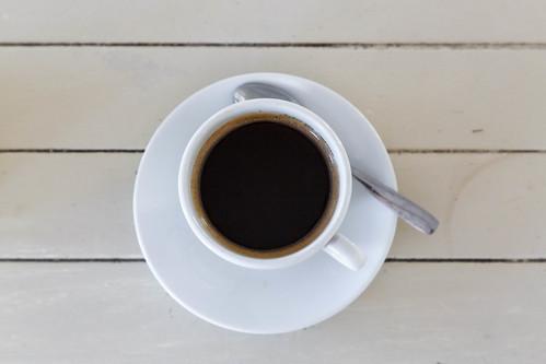 Black coffee (americano) on wooden  background