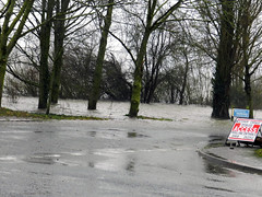 Flooding in a UK, England street. Free to use flooding stock photo