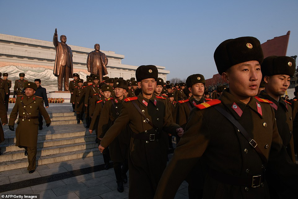 Groups ranging from couples and families to hundreds-strong detachments of workers or soldiers assembled in front of the statues. Here, Korean People's Army (KPA) soldiers leave after paying their respects to the former leader on the 77th anniversary of his birth, February 16, 2019. AFP/Getty Images photo.