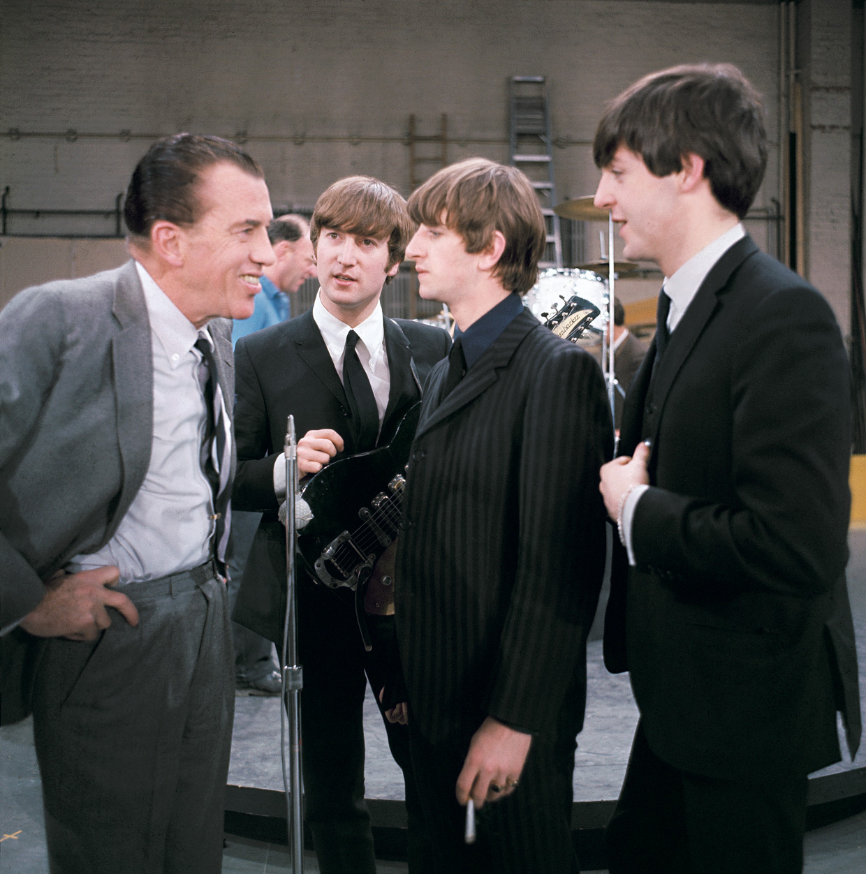 Ed Sullivan chatting with three of the four Beatles, February 9, 1964 (George Harrison was at the hotel with a fever).