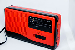 Red mini radio on white background