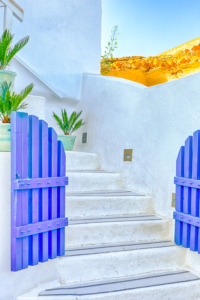 European Destinations. Ancient Blue Gates and White Stairs in One of Oia Village Houses on Santorini Island in Greece.