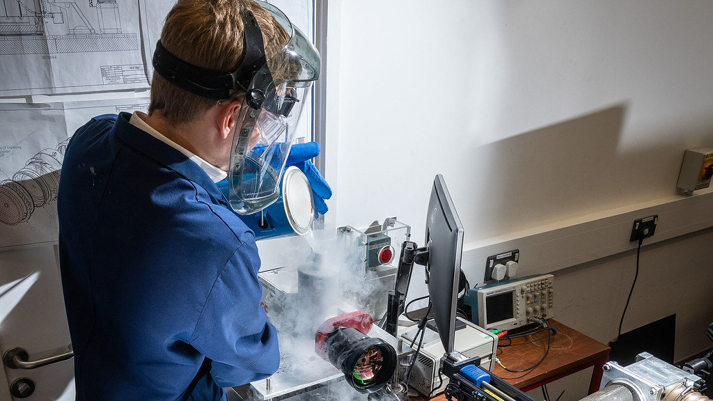 Person using the film cooling rig in a lab