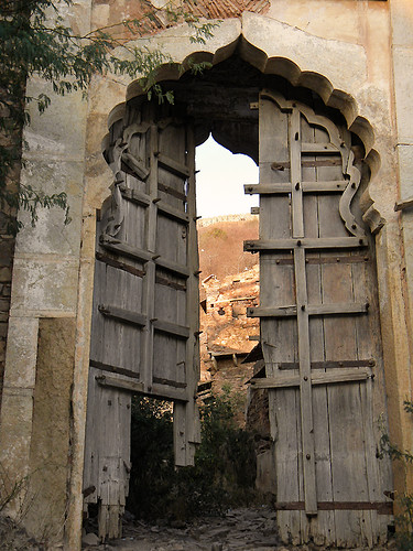 Old wood door in Bundi Fort in the hills above Bundi, India