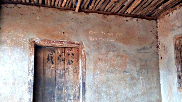Wooden door with inscription which reads' Ebola is Real' in Limba