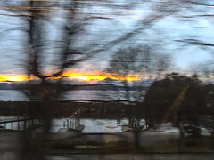 Catching the post sunset glow over the Olympic Mountains, across the Puget Sound. From northbound Amtrak Cascades Train 518, just north of Ballard Locks. #amtrakcascades #amtrak  @amtrak