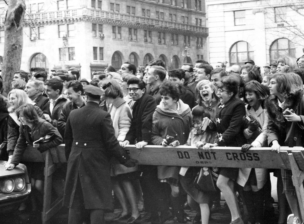 Crowds waiting for The Beatles outside of their hotel in New York on February 7, 1964.