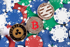 Poker chips with cryptocurrency coins