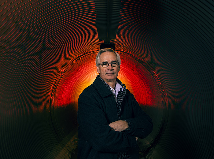 A man standing in a tunnel.