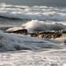 Rocky seashore with wavy ocean and waves crashing on the rocks