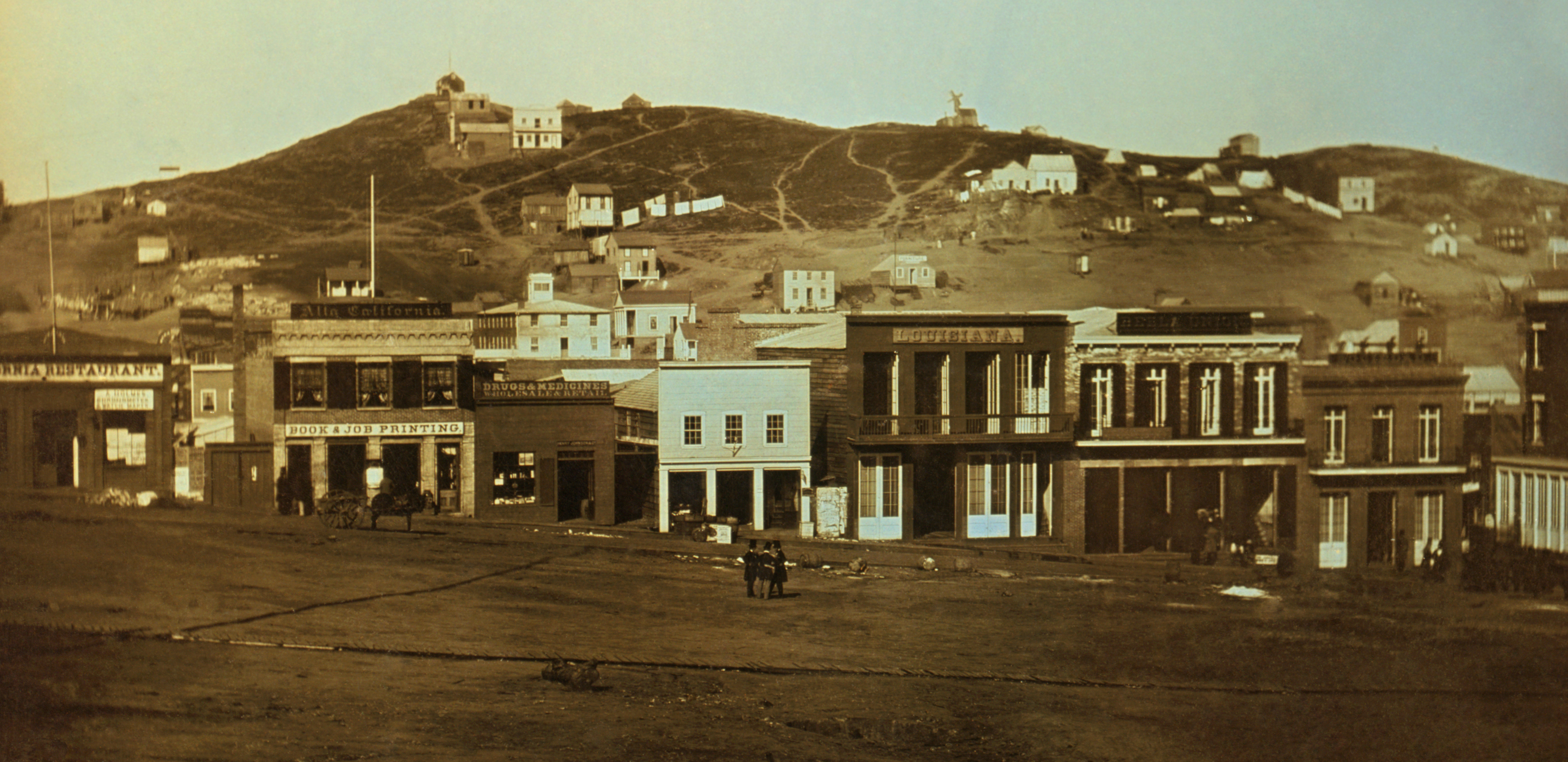 Portsmouth Square, near San Francisco harbor, during the Gold Rush, 1851. Signs in image include: California Restaurant, Book and Job Printing, Louisiana, Sociedad, Drugs & Medicines Wholesale & Retail, Henry Johnson & Co, Alta California, Bella Union, A. Holmes.
