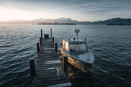 Boat with an Island at the Chiemsee at Sunrise from Toni Hoffmann