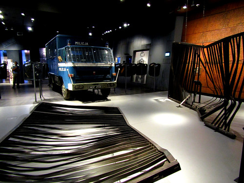 Police car and broken fences in the museum of the European Solidarity Centre in Gdansk