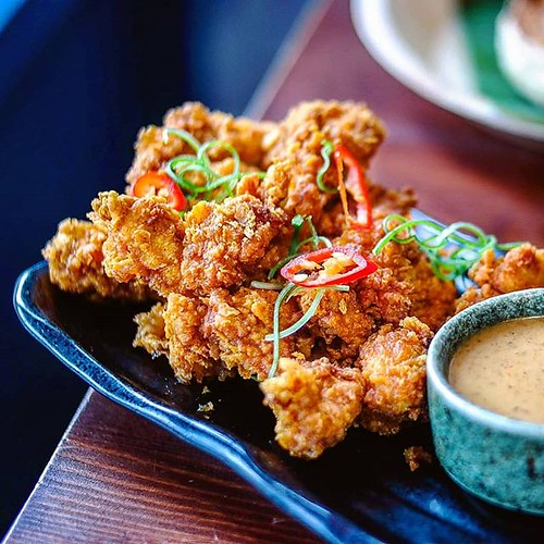 One of my favourites from @sambalshiok - the #Malaysian #friedchicken with #satay peanut dipping sauce. Loved by other diners and food critics alike. Make sure you get a portion when you visit. . . #foodofinstagram #igfood #foodgram  #buzzfeast  #feedfeed | by Angela Sam (@SheLives2Eat)