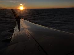 plane wing at sunset dramatic lighting