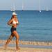 Running girl, Nai Harn beach, Phuket island, Thailand      XOKA9602bs
