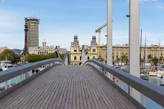 Close-up of wooden bridge and sight Rambla de Mar which connects Portal de la Pau and Moll d'Espanya in Barcelona (Spain)